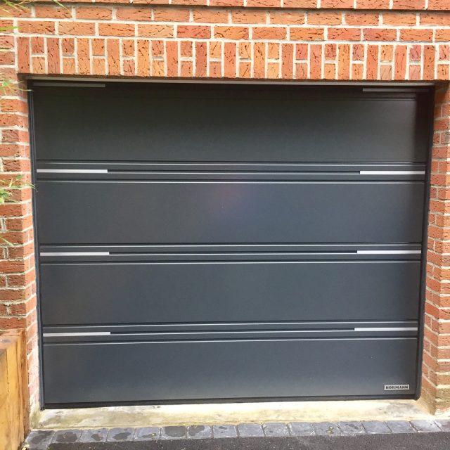https://mister-chassis.be/wp-content/uploads/2016/05/Porte-de-garage-sectionnelle-640x640.jpg